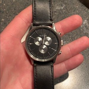 Black leather band chronograph Nixon watch